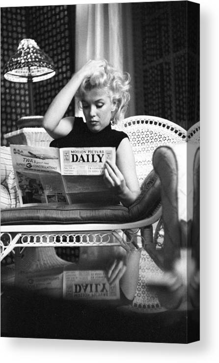 People Canvas Print featuring the photograph Marilyn Relaxes In A Hotel Room by Michael Ochs Archives