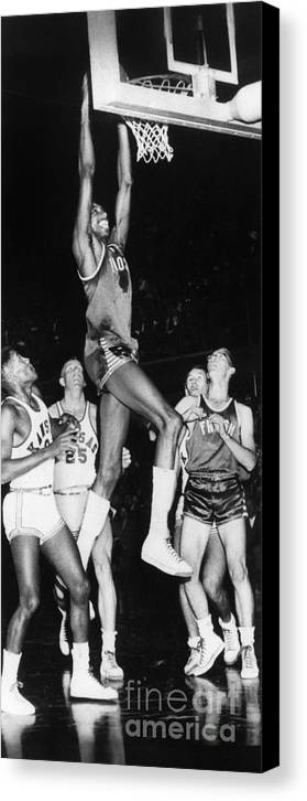 1956 Canvas Print featuring the photograph Wilt Chamberlain (1936-1999) by Granger