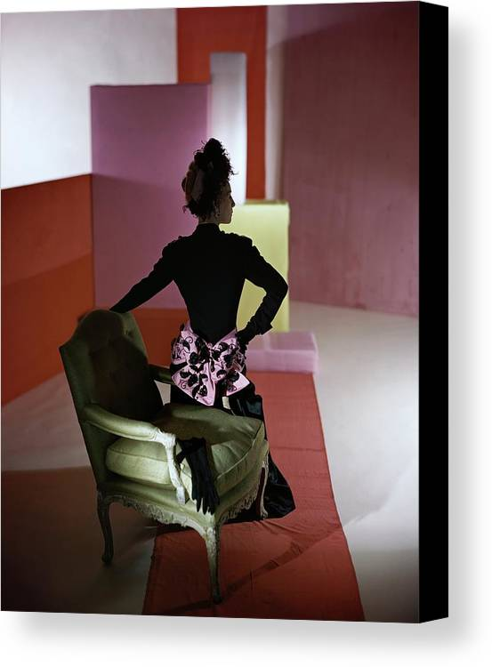 Fashion Canvas Print featuring the photograph A Model Wearing A Schiaparelli Dress by Horst P. Horst
