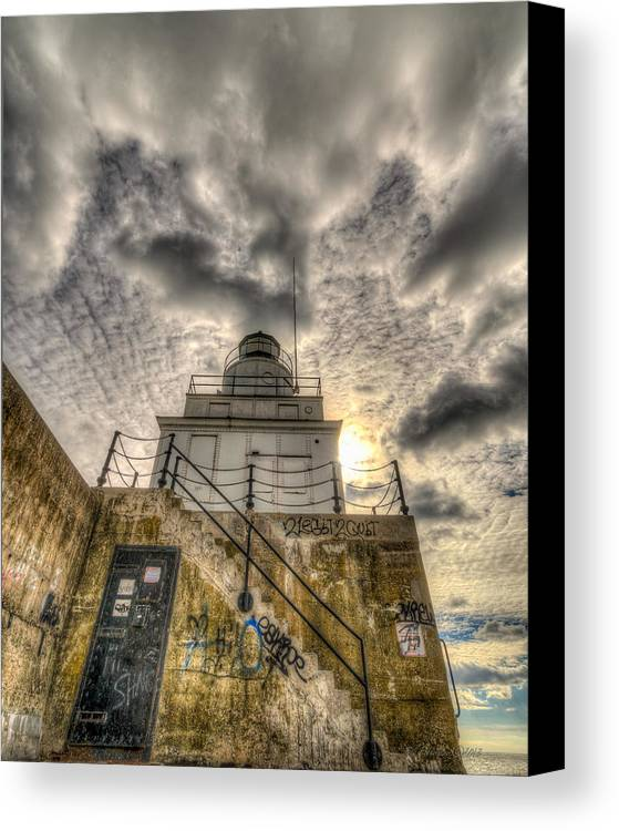 Great Lakes Canvas Print featuring the photograph A Rising Light by Bill Pohlmann
