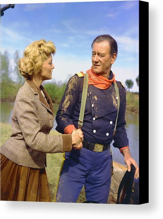 The Horse Soldiers Canvas Print featuring the photograph John Wayne In The Horse Soldiers by Silver Screen