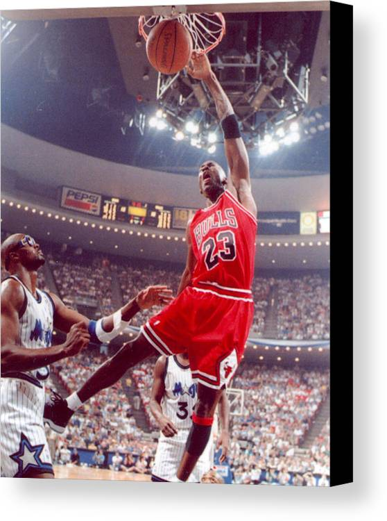 Classic Canvas Print featuring the photograph Michael Jordan Dunks With Left Hand by Retro Images Archive