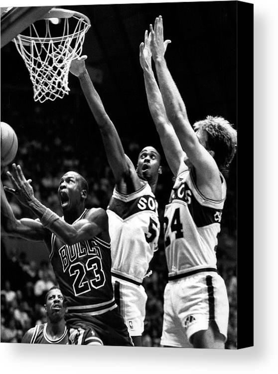 Classic Canvas Print featuring the photograph Michael Jordan Going For A Hard Layup by Retro Images Archive