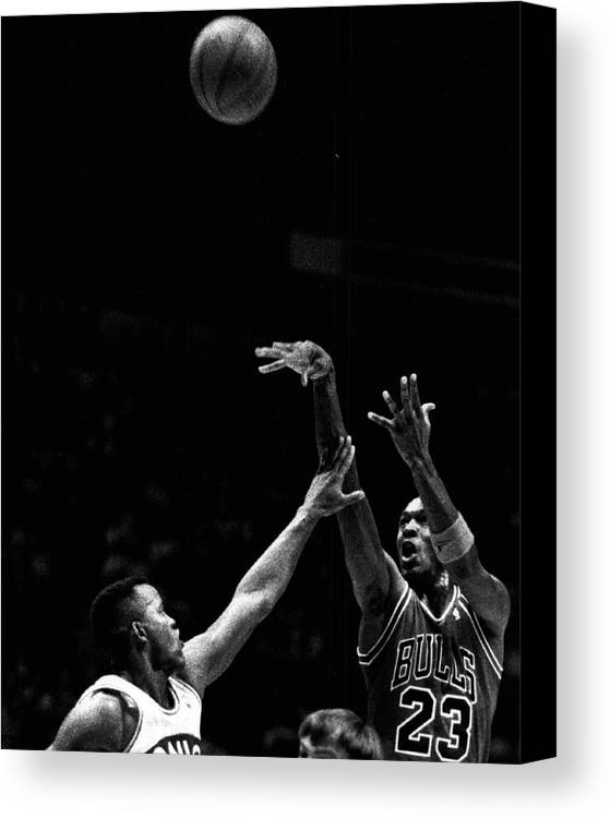 Classic Canvas Print featuring the photograph Michael Jordan Shooting Over Another Player by Retro Images Archive