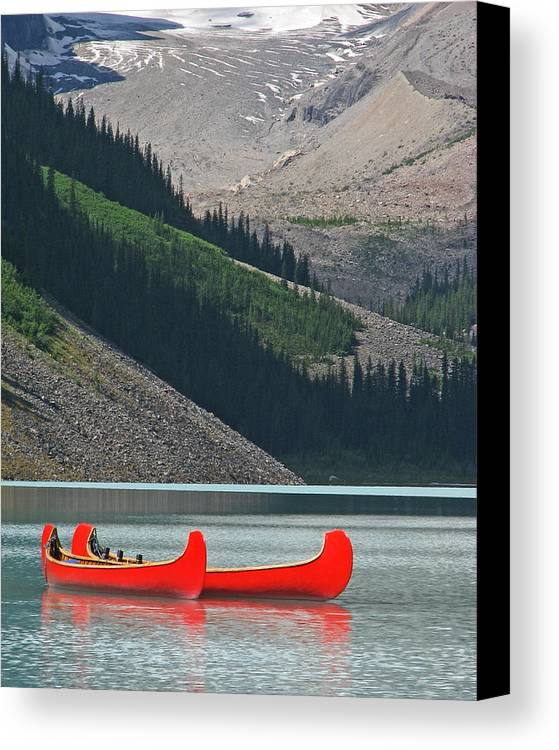 Red Canvas Print featuring the photograph Mountain Canoes by Marcia Socolik