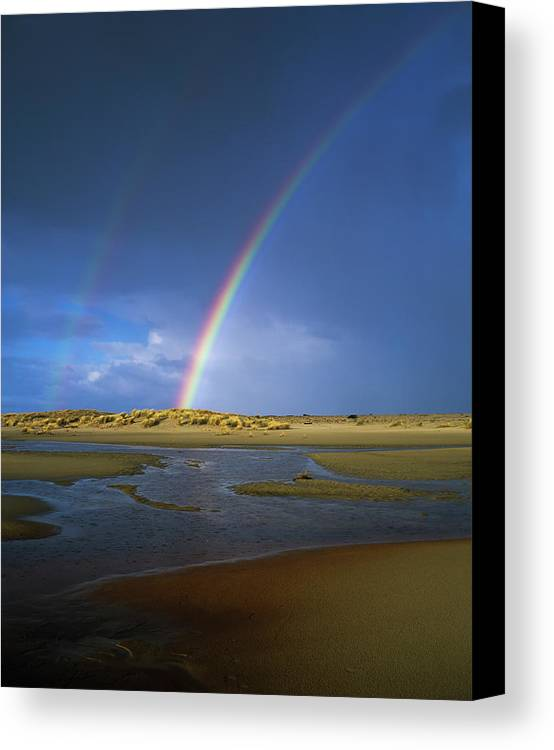 Oregon Dunes National Recreation Area Canvas Print featuring the photograph Rainbow Appears Over The Mouth by Robert L. Potts