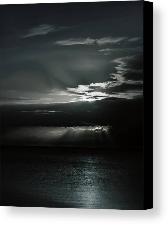 Ocean Canvas Print featuring the photograph When The Sun Goes Down... by Mario Celzner