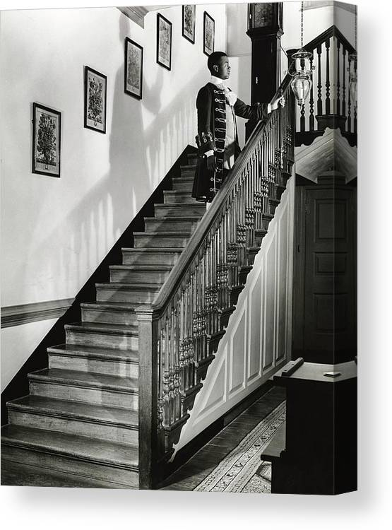 Antique Canvas Print featuring the photograph Man Dressed As Colonial Butler On The Stair by George Karger