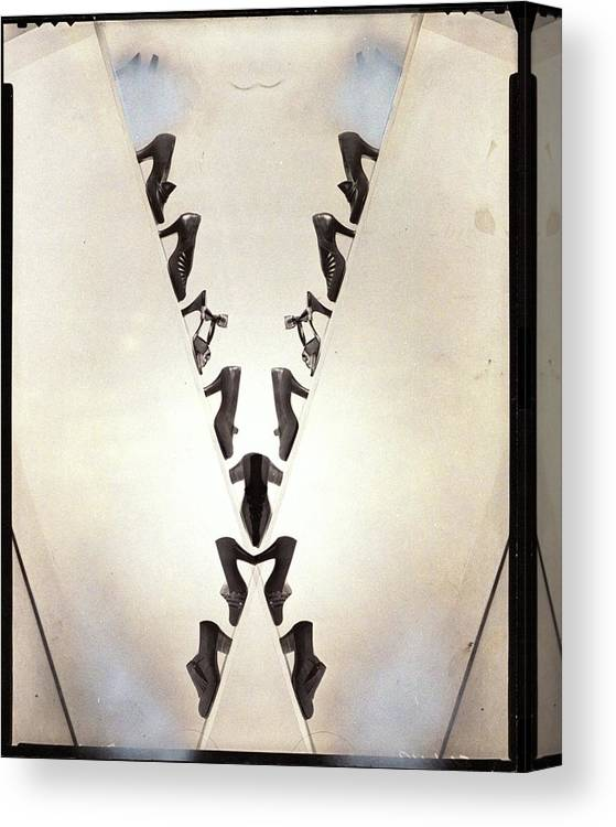 Nobody Canvas Print featuring the photograph Two Lines Of Shoes Reflected by Cecil Beaton