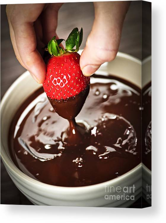 Strawberry Canvas Print featuring the photograph Dipping Strawberry In Chocolate by Elena Elisseeva