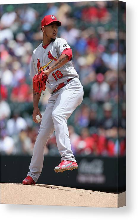 St. Louis Cardinals Canvas Print featuring the photograph St Louis Cardinals V Colorado Rockies by Doug Pensinger