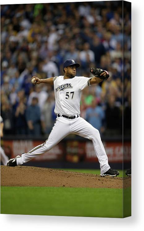 Wisconsin Canvas Print featuring the photograph Atlanta Braves V Milwaukee Brewers by Mike Mcginnis