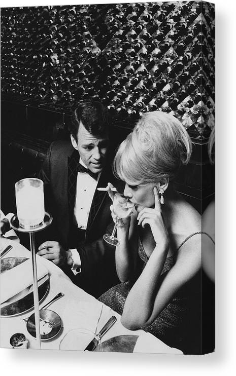 Architecture Canvas Print featuring the photograph A Glamorous 1960s Couple Dining by Horn & Griner