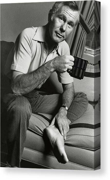 Personality Canvas Print featuring the photograph A Portrait Of Johnny Carson Sitting by Bruce Bacon