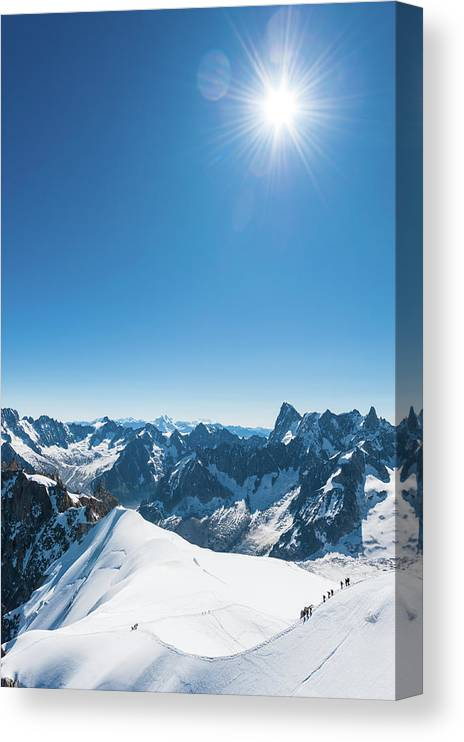Scenics Canvas Print featuring the photograph Alps Snow Summit Sunburst Mountaineers by Fotovoyager
