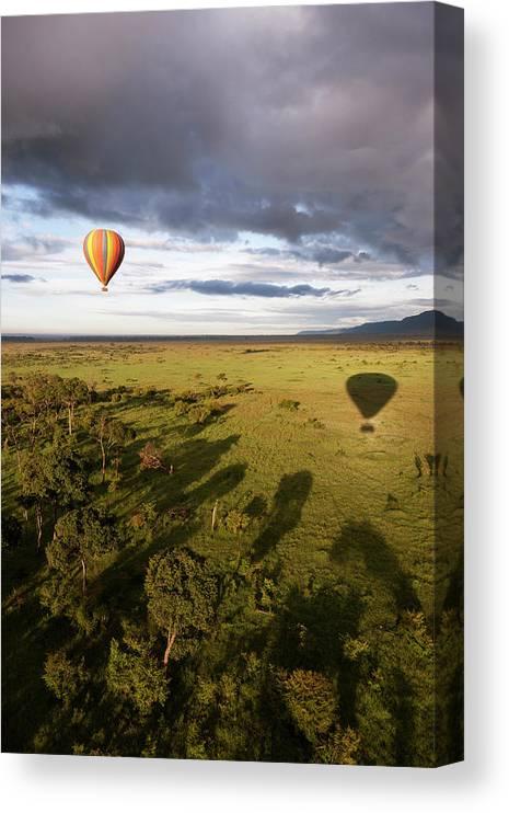 Kenya Canvas Print featuring the photograph Balloon In Masai Mara National Park by Luis Davilla