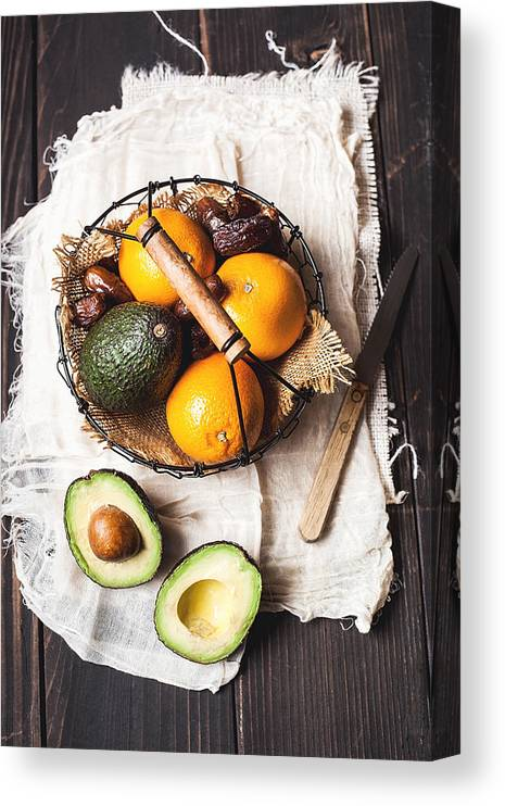 San Francisco Canvas Print featuring the photograph Basket With Avocado, Oranges And Dates by One Girl In The Kitchen