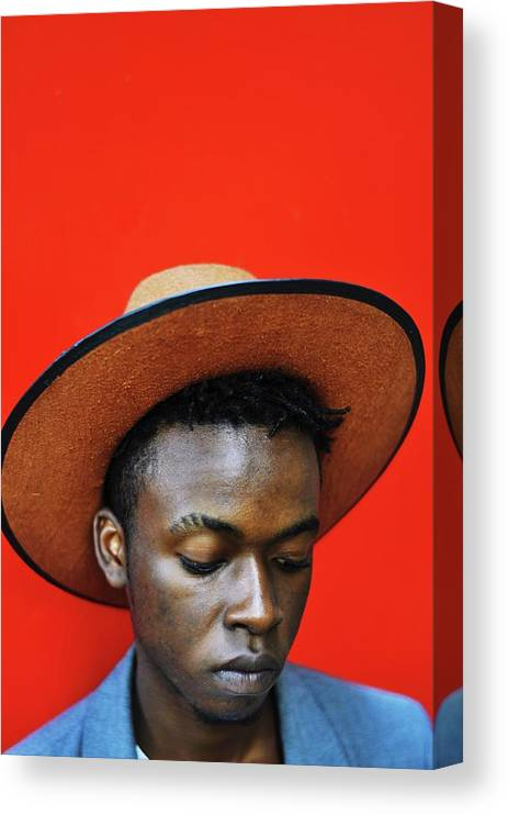 Young Men Canvas Print featuring the photograph Close-up Of Man Wearing Hat Against Red by Samson Wamalwa / Eyeem