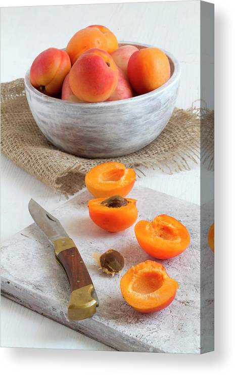 Cutting Board Canvas Print featuring the photograph Cross Section Apricots With Knife And by Westend61
