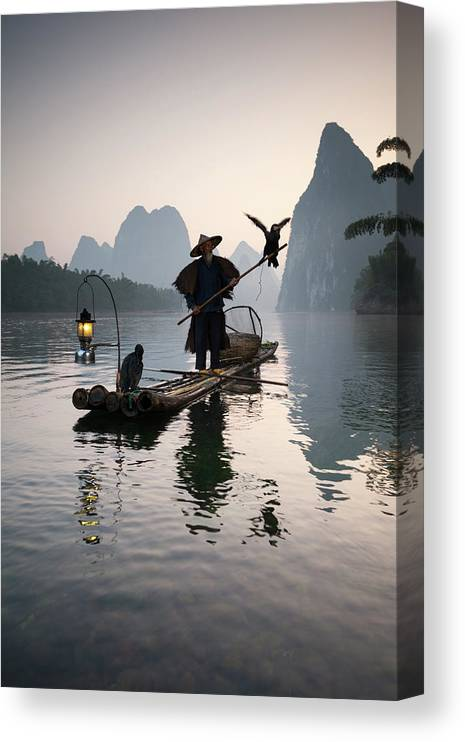 Chinese Culture Canvas Print featuring the photograph Fisherman With Cormorants On Li River by Matteo Colombo
