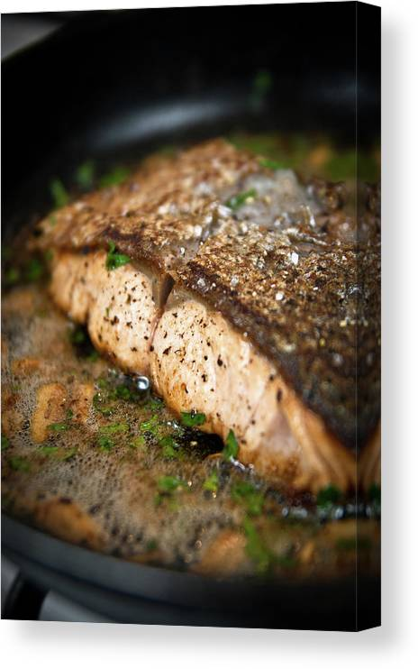 Garlic Canvas Print featuring the photograph Frying Salmon On Pan by Wojciech Wisniewski