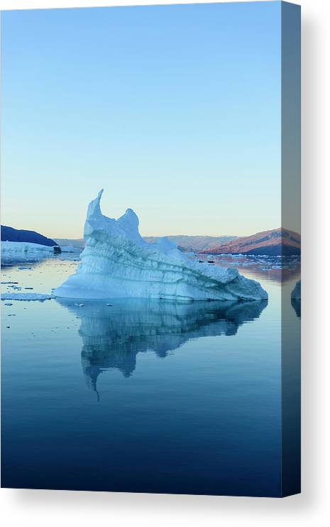 Scenics Canvas Print featuring the photograph Iceberg In The Scoresby Sund by Berthold Trenkel