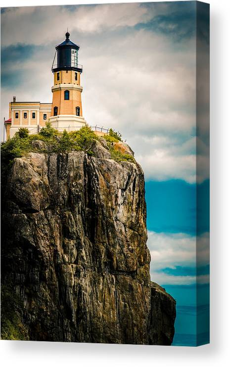 Two Harbors Canvas Print featuring the photograph Lighthouse On Split Rock by Ever-Curious Photography
