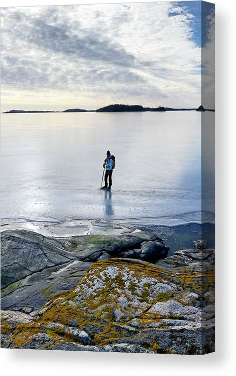 Archipelago Canvas Print featuring the photograph Person Skating At Frozen Sea by Johner Images