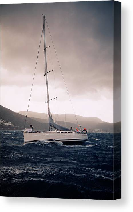 Recreational Pursuit Canvas Print featuring the photograph Sailing And Stormy Weather by Travenian