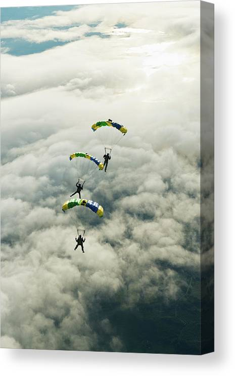 Young Men Canvas Print featuring the photograph Skydivers In Mid-air by Johner Images