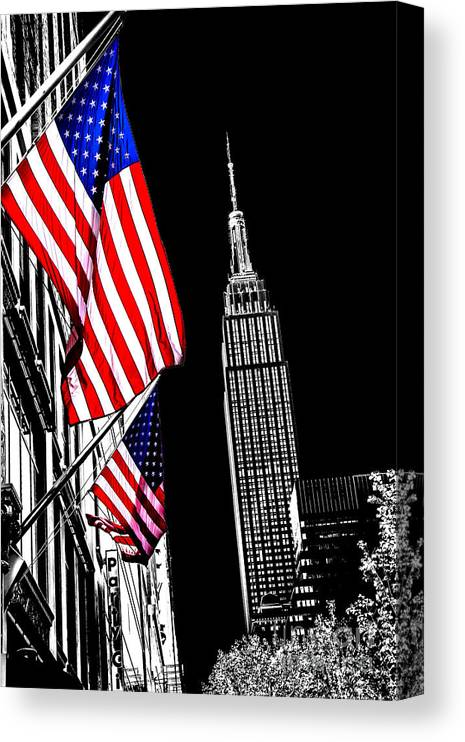 Empire State Building Canvas Print featuring the photograph The Flag That Built An Empire by Az Jackson