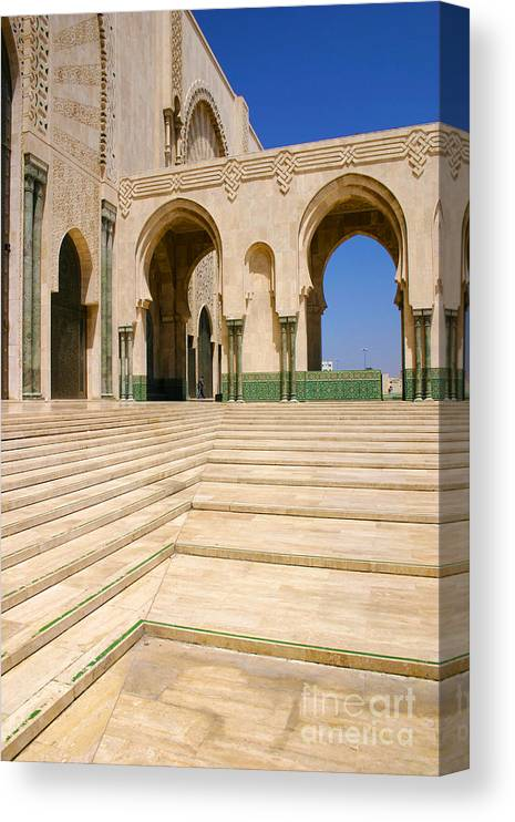 Colonnades Leading To Mosque Canvas Print featuring the photograph The Massive Colonnades leading to the Hassan II Mosque Sour Jdid Casablanca Morocco by PIXELS XPOSED Ralph A Ledergerber Photography