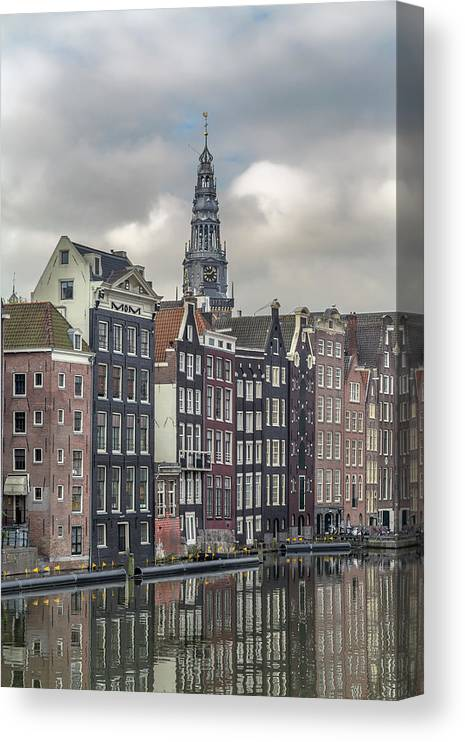 In A Row Canvas Print featuring the photograph Traditional Dutch Houses Over A Canal by Buena Vista Images