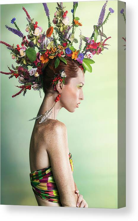 Art Canvas Print featuring the photograph Woman Wearing A Colorful Floral Mohawk by Paper Boat Creative