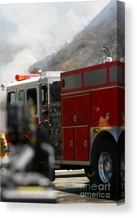 Ash Canvas Print featuring the photograph Barnett Fire by Henrik Lehnerer