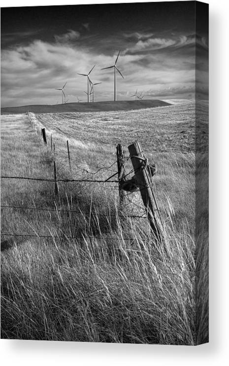 Power Canvas Print featuring the photograph Fence Corner And Wind Turbines On A Farm In Alberta by Randall Nyhof