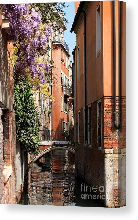 Venice Canvas Print featuring the photograph Canal in Venice with Flowers by Michael Henderson
