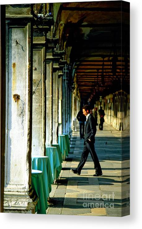 San Marco Canvas Print featuring the photograph Waiter Walking at San Marco in Venice by Michael Henderson