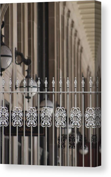 Union Station Canvas Print featuring the photograph White Wrought Iron Gate in Chicago by Colleen Cornelius