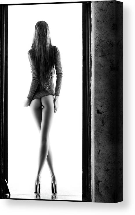 Woman Canvas Print featuring the photograph Woman standing in doorway by Johan Swanepoel