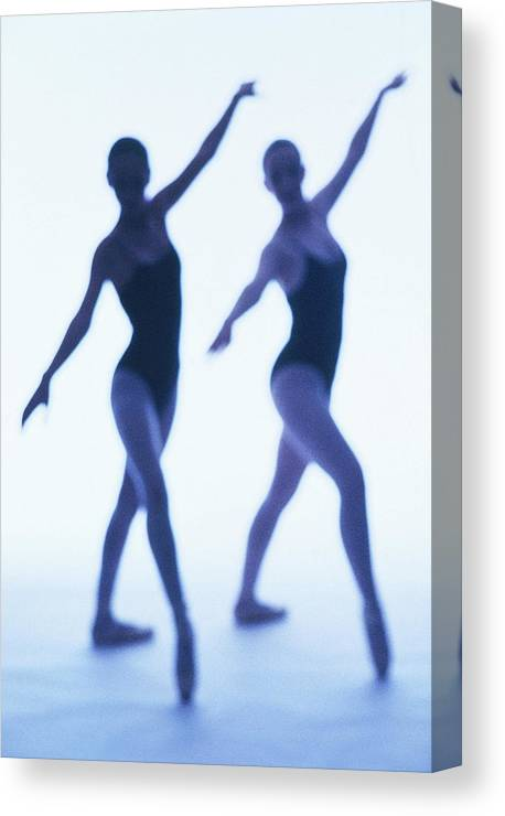 Ballet Dancer Canvas Print featuring the photograph A Silhouette Of Two Young Women by George Doyle