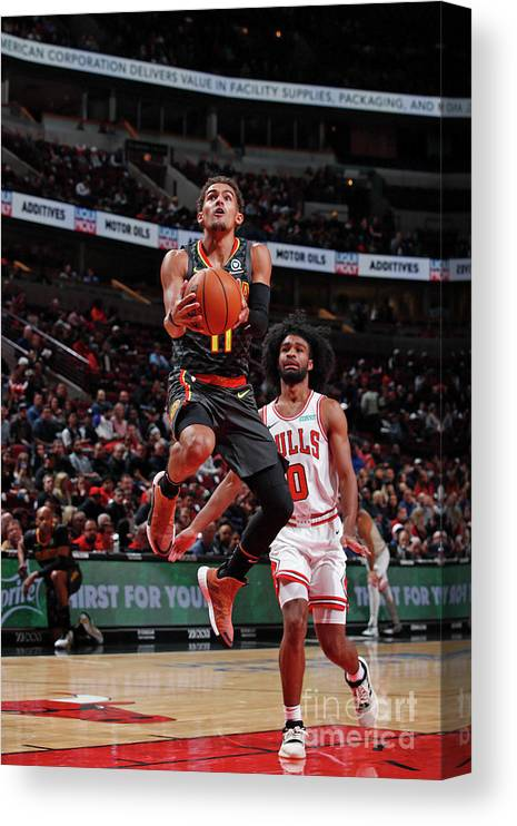 Nba Pro Basketball Canvas Print featuring the photograph Atlanta Hawks V Chicago Bulls by Jeff Haynes