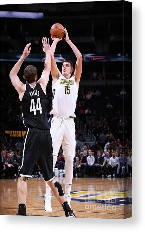 Nba Pro Basketball Canvas Print featuring the photograph Brooklyn Nets V Denver Nuggets by Garrett Ellwood