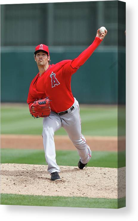American League Baseball Canvas Print featuring the photograph Los Angeles Angels Of Anaheim V Oakland by Sarah Crabill