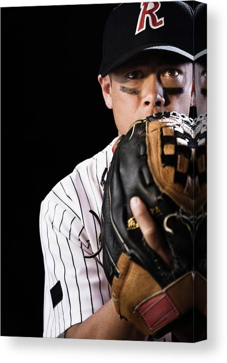 Baseball Cap Canvas Print featuring the photograph Mixed Race Baseball Player Pitching by Hill Street Studios