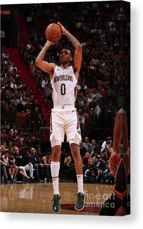 Nba Pro Basketball Canvas Print featuring the photograph New Orleans Pelicans V Miami Heat by Issac Baldizon