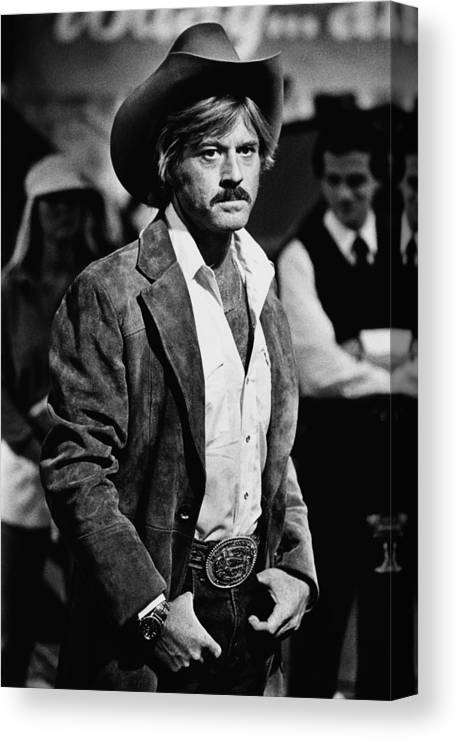 Sydney Pollack Canvas Print featuring the photograph Robert Redford Stars In The by George Rose