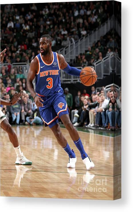 Tim Hardaway Jr. Canvas Print featuring the photograph New York Knicks V Milwaukee Bucks by Gary Dineen