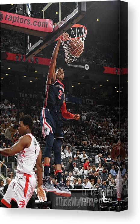 Playoffs Canvas Print featuring the photograph Washington Wizards V Toronto Raptors - by Ron Turenne