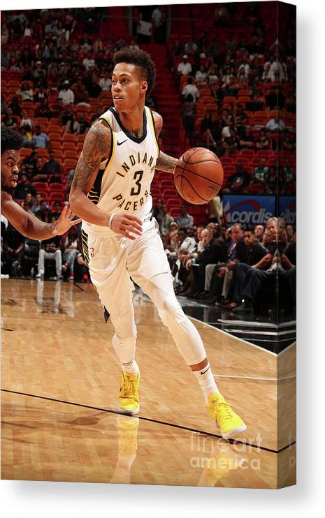 Nba Pro Basketball Canvas Print featuring the photograph Indiana Pacers V Miami Heat by Issac Baldizon